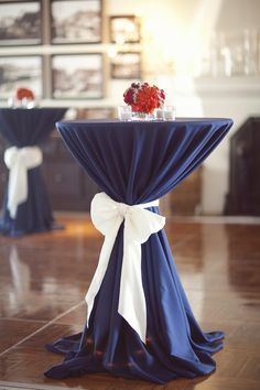A blue table linen with a silver sash to tie in the event colors.