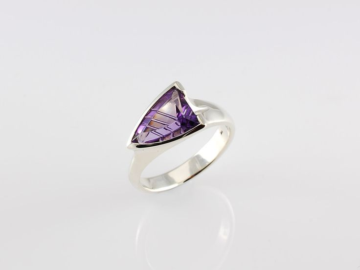 -Adelaide ring-  Silver with  fantasy cut Amethyst. Occasionally we get our hands on some unusual stones and get to create fantastic eye catchers like our Adelaide ring. This one is sold but feel free to ask us to create a special ring for you. Check out our website https://jewelbeetle.co.nz or our  gallery on smugmug https://jewelbeetle.smugmug.com