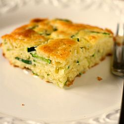 Zucchini Squares Recipe INGREDIENTS: 5 eggs, lightly beaten ½ cup vegetable oil ½ cup grated Romano cheese 2 tablespoons chopped fresh parsley ½ teaspoon salt ½ teaspoon seasoned salt ½ teaspoon dried oregano ¼ teaspoon garlic powder ½ cup finely chopped yellow onion 2 cups Bisquick 3 cups thinly sliced zucchini