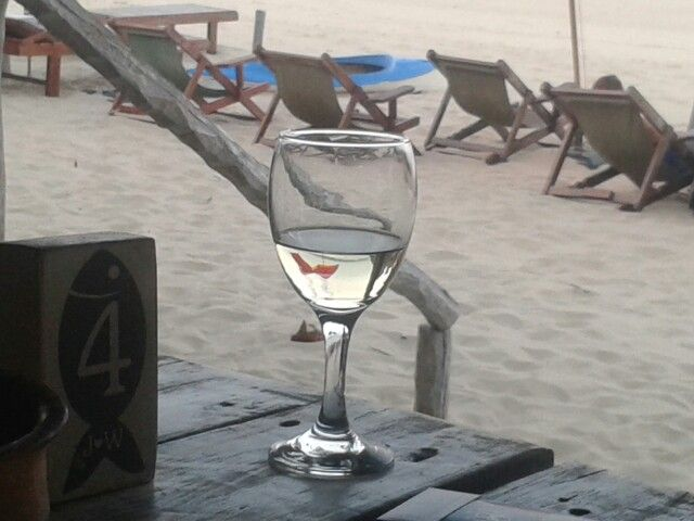 Chilling with a nice glass of white wine at Neptune's Bar.