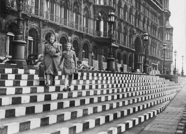 Mother with her daughter descending striped steps, London, September 1939 (Photo by Keystone-France/Gamma-Keystone via Getty Images)