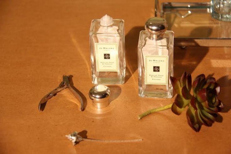 Usando vidros de perfumes na decor