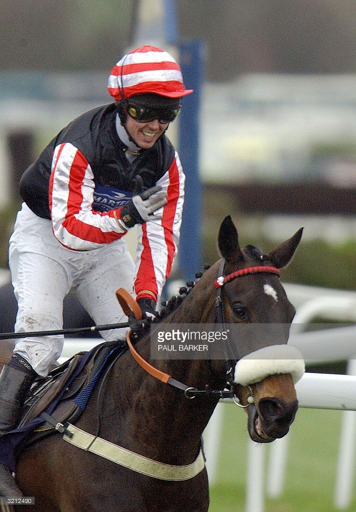 Graham Lee celebrates as he comes home to win the Grand National on Amberleigh House at Aintree racecourse in Liverpool, 03 April 2004. Amberleigh House won at 16-1 odds.