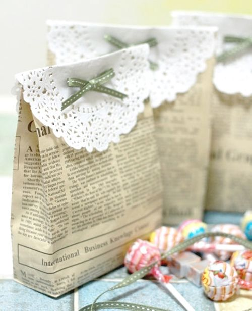 Gift bags made from newspaper and paper doilys.