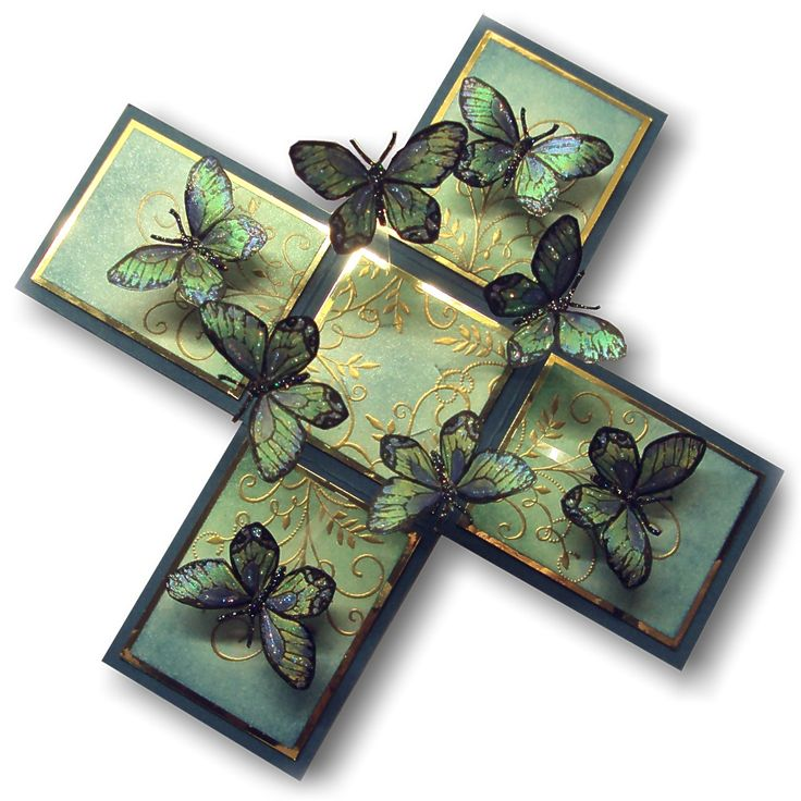 """Magic boxes that """"explode"""" with butterflies when you lift the lid ... the box falls open to reveal the interior where butterflies (or other embellishments) are attached to the inside panels with strips of acetate"""