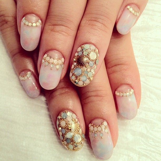 I dont like rounded nails like this but the decorations are gorgeous