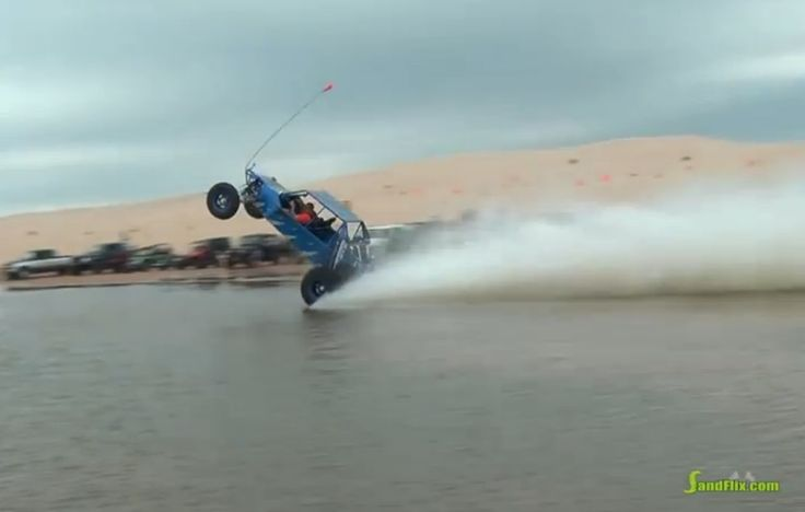 Watch This Sand Rail Pull A Massive Power Wheelie Across Water – Physics Be…