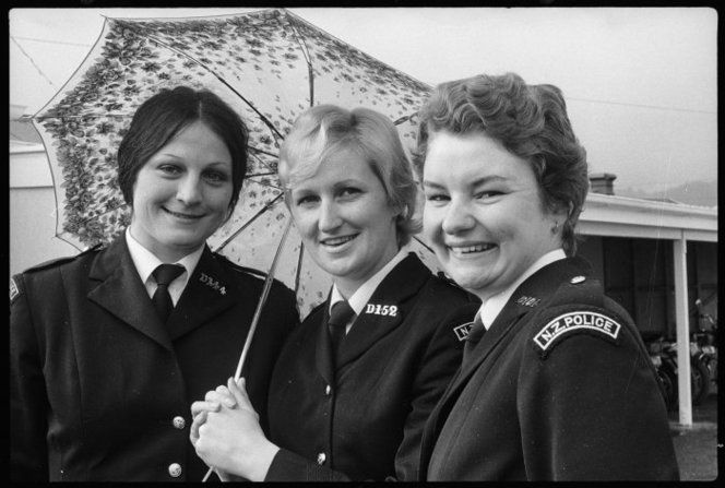 Three prizewinning police graduates, all women, from the Police Training School at Trentham. From left: Constable W H Marks (third place), Constable O E Hughes (first place), and Constable J Nettlefold (second place, and winner of the Prater Memorial Prize). Photograph taken 22 August 1974 by an unidentified Evening Post staff photographer.