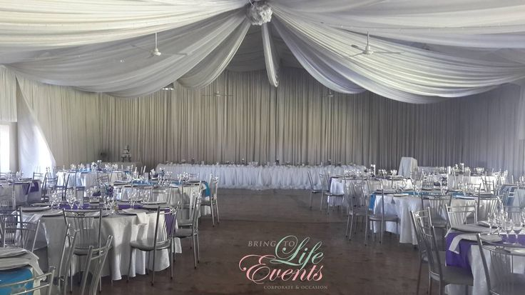 Gorgeous wedding with white draping, tiffany chairs, blue & purple colors. Orchids & lilies were used.