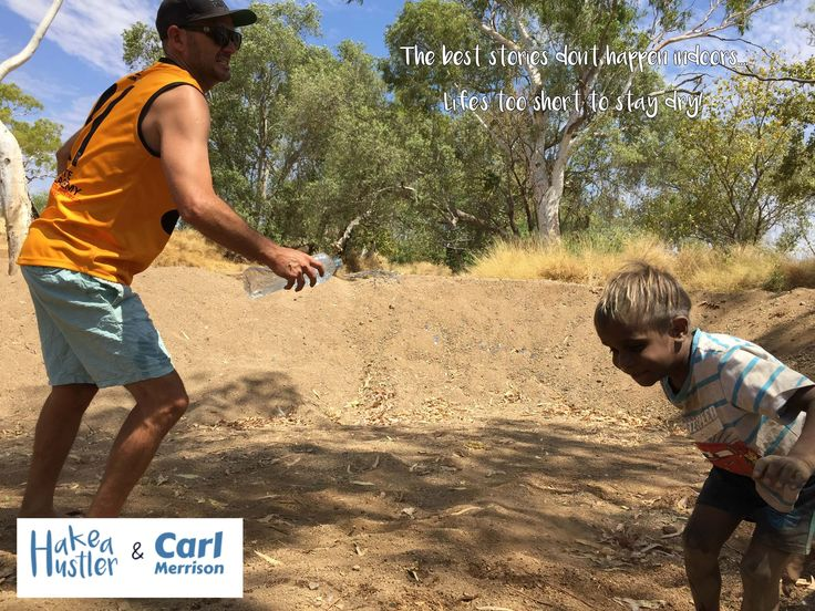 """""""Life's too short to stay dry"""". Author Carl Merrison playing in the Kimberley with young boy."""