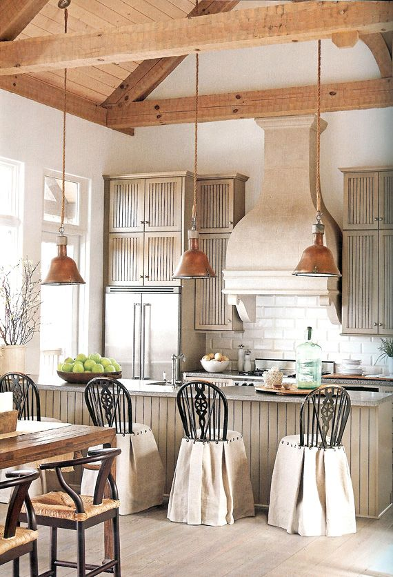 Cabin chic kitchen by Mimi Williams. Slipcovers for the Windsor counter top stools.