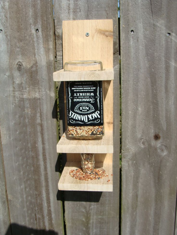 Jack Daniels Whiskey Bottle Bird Feeder. @Makayla Jennings Oei. And this!