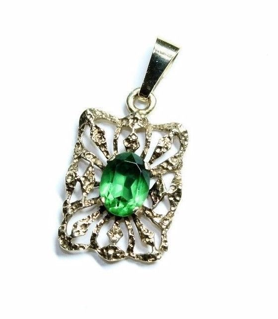 A pretty 9ct gold pendant set with a sparkly green rhinestone. It is fully hallmarked for a Birmingham import with a date letter that looks to be a T for 1993. There is also a maker mark which looks like H.S. | eBay!