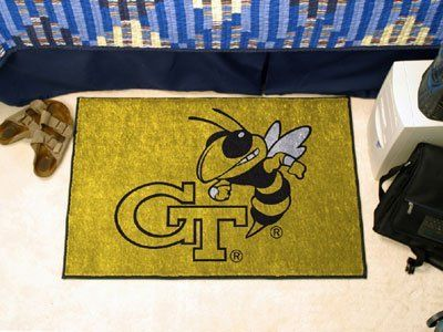"""Georgia Tech Starter Rug 20""""x30"""" by Fanmats. $13.68. Georgia Tech Starter Rug 20""""x30""""Decorate your home or office with area rugs by FANMATS. Made in U.S.A. 100% nylon carpet and non-skid recycled vinyl backing. Officially licensed and chromojet printed in true team colors. Please note: These products are custom made. The normal lead time is about 7-10 business days. However, the putting mats and carpet tiles do take a little longer, about 14-21 business days.***This item is expe..."""