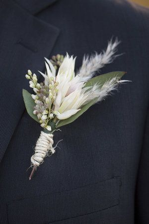 groom boutonniere with blushing bride protea.jpg