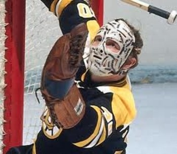 Gerry Cheevers won two Stanley Cups for the Boston Bruins in 1970 and 1972, and was one of the better NHL goalies in the '60s and '70s.  Cheevers became famous for wearing a mask which he added stitches to in order to show what his face would have endured had he not been wearing facial protection. Each time he was struck in the mask, more stitches were added to the mask.