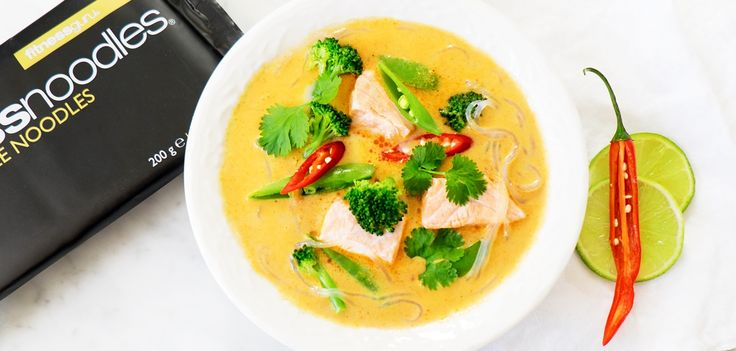 Healthy and spicy curry with salmon and Fitnessnoodles®.    2 servings1 package Fitness noodles®400 ml of Coconut Milk2-3 cups Water1 Lemongrass50 g fresh Ginger1-2 tbsp Red Curry Paste300 g Salmon fillet , diced1 Broccoli, split into small pieces150 g Sweet Peas2 Scallions, sliced2 tablespoons Asian Fish Sauce1 ½ Lime juice    Share lemon grass on the length and beat lightly with for example the top of the knife handle. Peel and shred ginger and scallions. Add lemon grass, curry paste…