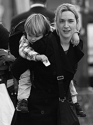 Kate Winslet, a very lovely lady playing horse to a rather adorable child. She's lovely. Very lovely!