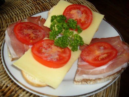 Typical German Breakfast ~ Buttered bread, sliced cheese, thinly sliced bacon, and tomatoes.