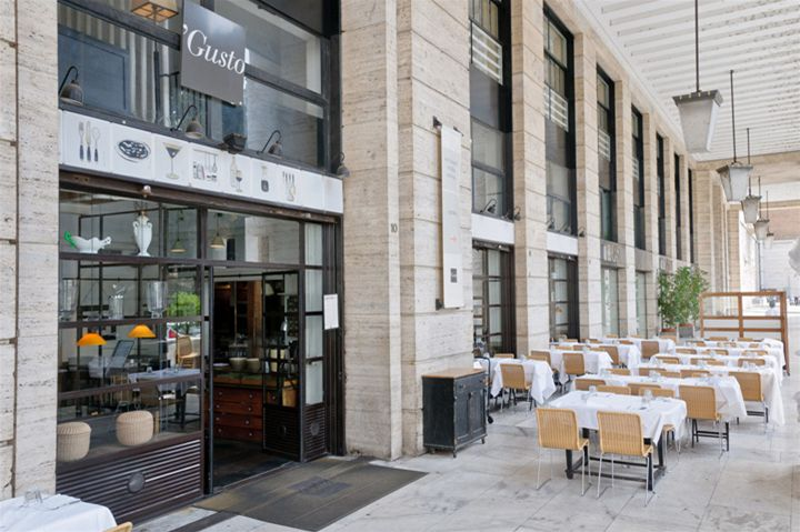 Gusto wine bar. Great selection of wines by the glass, and great E10 lunch deal - 1plate from the buffet and a glass of house wine. Cool interior and large shady terrace.