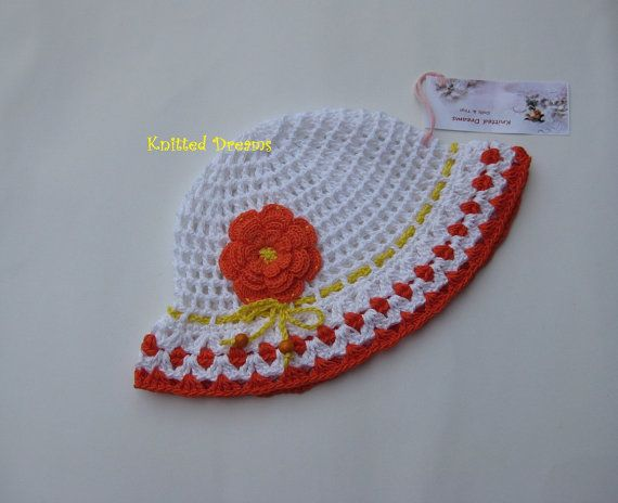 Crochet white cotton cap with large flower and cord  by tatocka