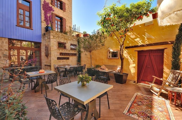 EXCLUSIVE SUITES BOUTIQUE HOTEL. MEDIEVAL TOWN, RHODES, GREECE. - Part of the yard with the tangerine tree.- kokkiniporta.com