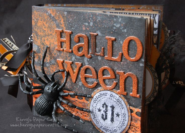 Halloween paper bag album.  Love this!  I have been wanting to make a mini album just for Halloween costumes for awhile now.