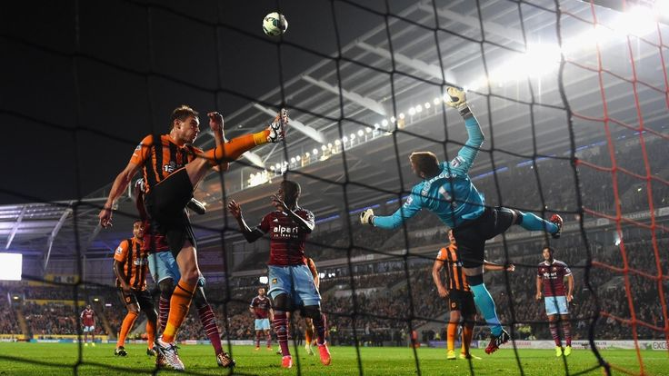 West Ham came from behind twice to deny Hull City victory at the KC Stadium in their Premier League football match. Here Hull's Nikica Jelavic (left) and goalkeeper Allan McGregor clear the ball from in front of their goal