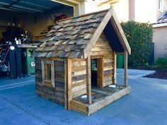 Pallet dog house made with pallet wood and 2x4's and plywood structure.