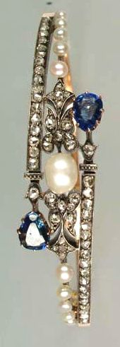 A late 19th century pearl, diamond and sapphire hinged bangle, circa 1890 So…