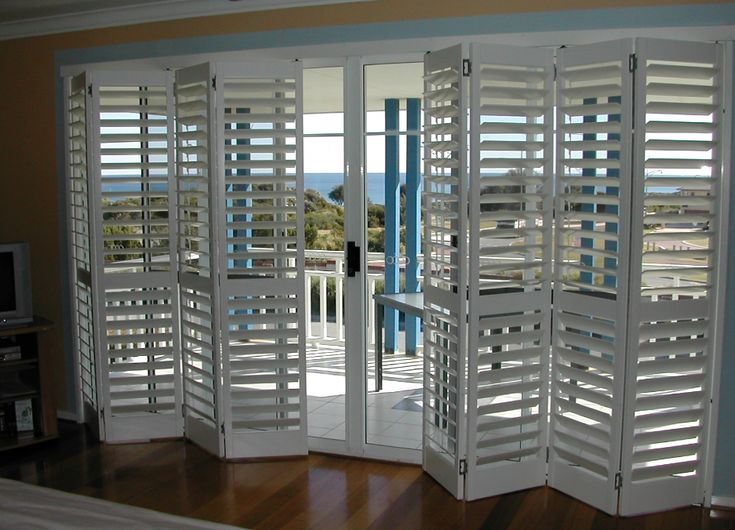 Bifold shutters over sliding glass doors