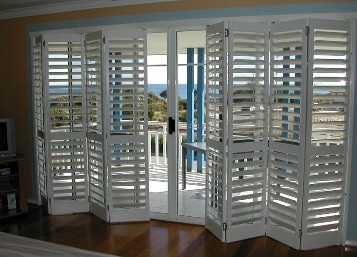 Bifold shutters over sliding glass doors