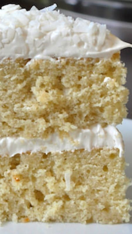 Coconut Velvet Cake ~ A beautifully moist and tender crumbed cake, flavoured with coconut milk and extract, then covered in a coconut marshmallow frosting and covered in a generous garnish of dried coconut.