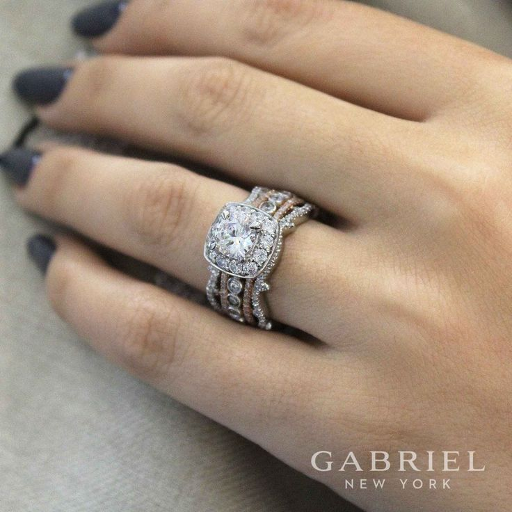 Gabriel NY - Preferred Fine Jewelry and Bridal Brand. 18k White gold /Rose Gold Round Halo Engagement Ring. Get the impact of five bands with one in this breathtaking free form diamond engagement ring mixing white and rose gold. Find your nearest retailer-> https://www.gabrielny.com/storelocator