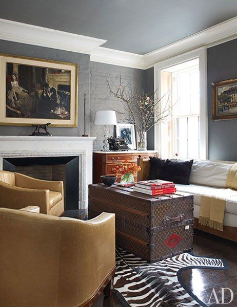 At Brooke Shield's West Village home-Ruhlmann-esque tub chairs by Stephen Miller Siegel face a vintage Louis Vuitton trunk given to Shields by her husband, Chris Henchy; the Directoire-style commode in the corner displays a George Hurrell portrait of the actress.