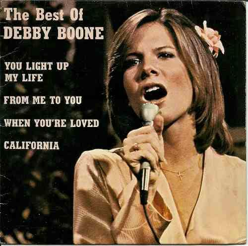 "Debby Boone...1977, the year I was born, her ""You Light Up My Life"" was the number one song in the nation. Anyone else wanna put a hit out on this woman?!"