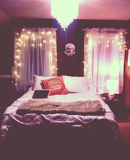 cozy bedroom.white lights. Marilyn Monroe. brown and white. comfy bedding. bedroom chandelier.