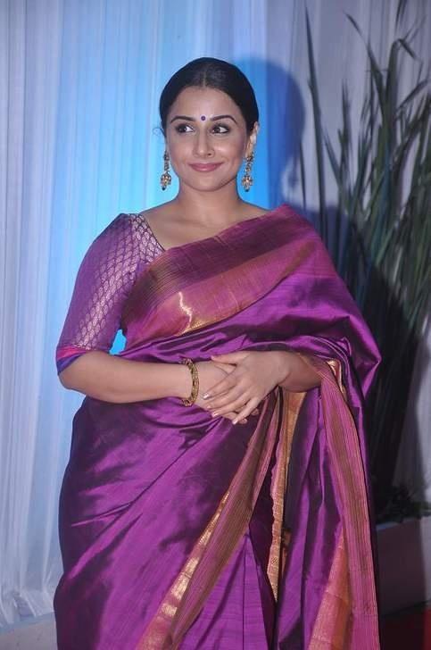 Vidya dazzles in a royal purple Kanjeevaram.