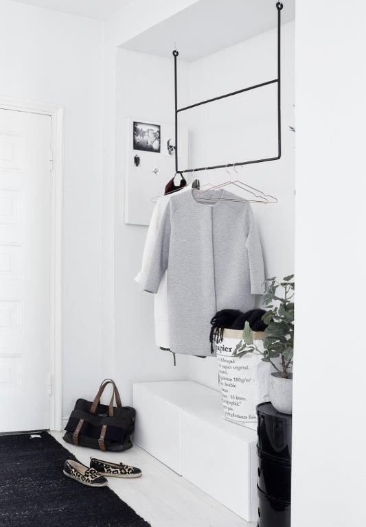 turn that hallway closet into an open coat hanger sitting shoe storage space