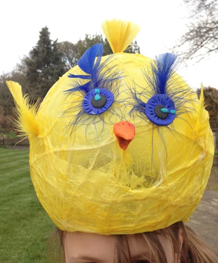 Easter bonnet made with wool and paper mâché. Eyes and beak made with Fimo