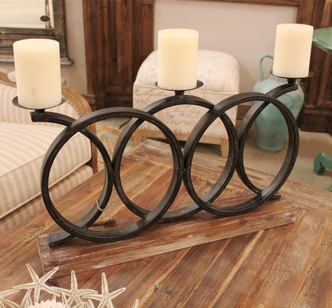Modern meet classic. Wrought Iron candle holder! Visit stonecountyironworks.com for more beautiful wrought iron designs!