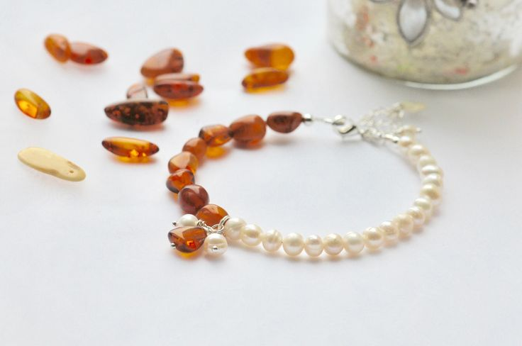 A personal favorite from my Etsy shop https://www.etsy.com/uk/listing/554370737/beautiful-amber-and-freshwater-pearls