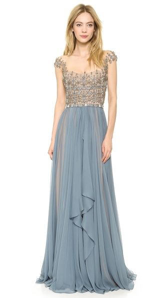 Reem Acra Embroidered Illusion Drop Shoulder Gown  If in white could be a beautiful wedding dress too. Love the elegance of the bottom coupled with the rigidness of the stones on top.