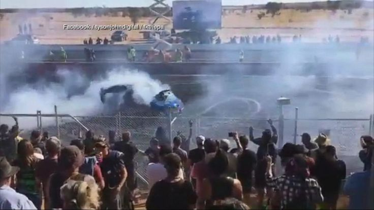 A car spitting exhaust fumes from its tailpipe while performing burnouts hit spectators at a Central Australian speedway event, sending 11 people to the hospital, the Australian Broadcasting Corporation reported.   Of the thousands of people who descended upon a weekend car racing event in the... - #Australian, #Burn, #Car, #Flames, #Racetrack, #Spectators, #TopStories