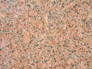 Granite containing potassium feldspar, plagioclase feldspar, quartz, and biotite and/or amphibole