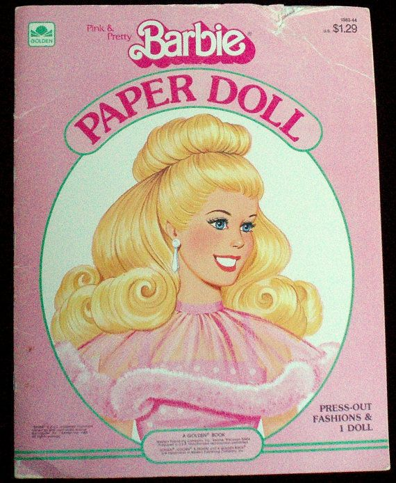 Barbie paper dolls. I also used to cut the pictures out of the Barbie booklet and played with those...and made a city for them.