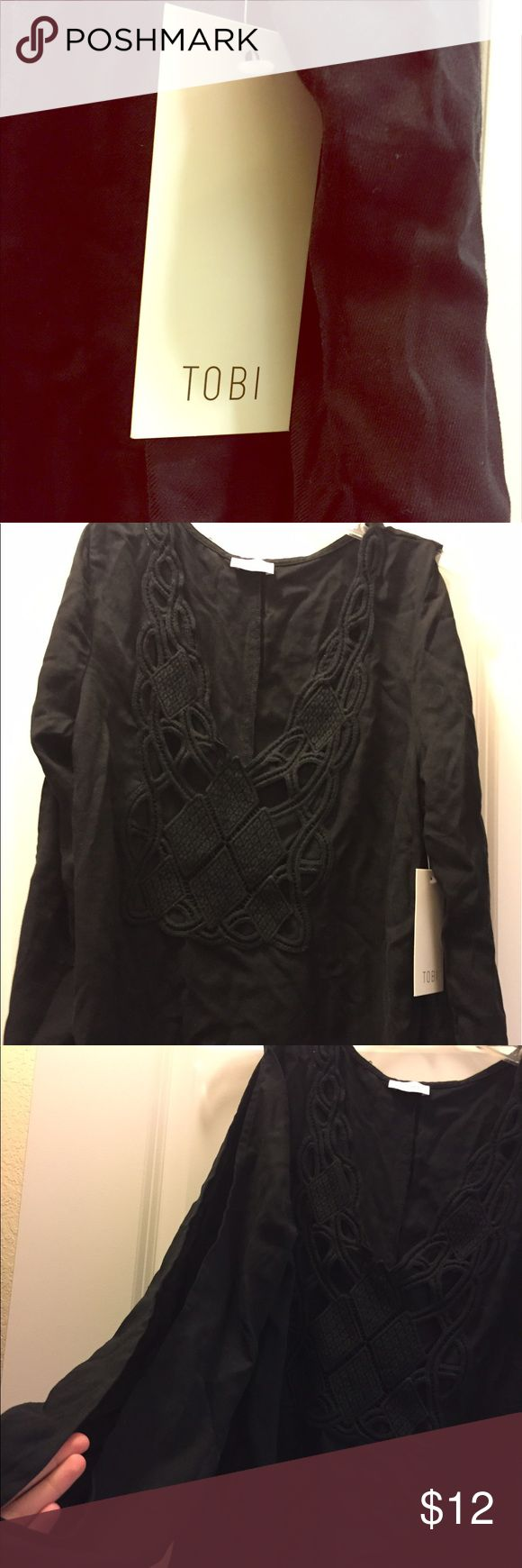 Tobi Black Dress with open long sleeves crochet Black dress with v-neck crochet design. Open long sleeves. Perfect for a festival or a night out! Never worn. NWT. Sold out on Tobi: Nena Crochet Dress Tobi Dresses Long Sleeve