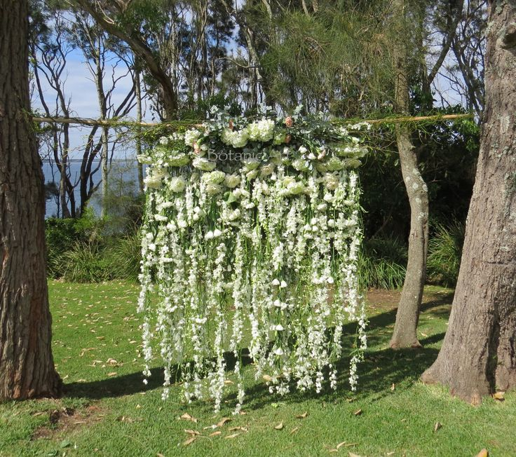 Wedding ceremony backdrop, white flowers, floral garland, floral cascade, flower waterfall, flower curtain, flower wall, country chic.