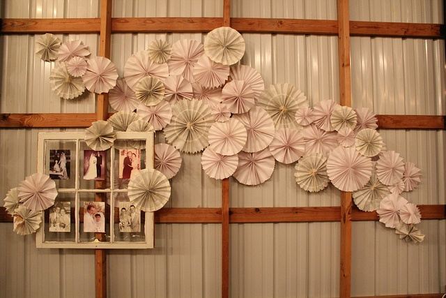 Easy paper pinwheels make a great statement in a wall cluster for parties