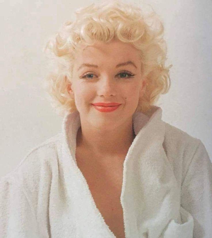 Marilyn. White robe sitting. Photo by Milton Greene, 1955.